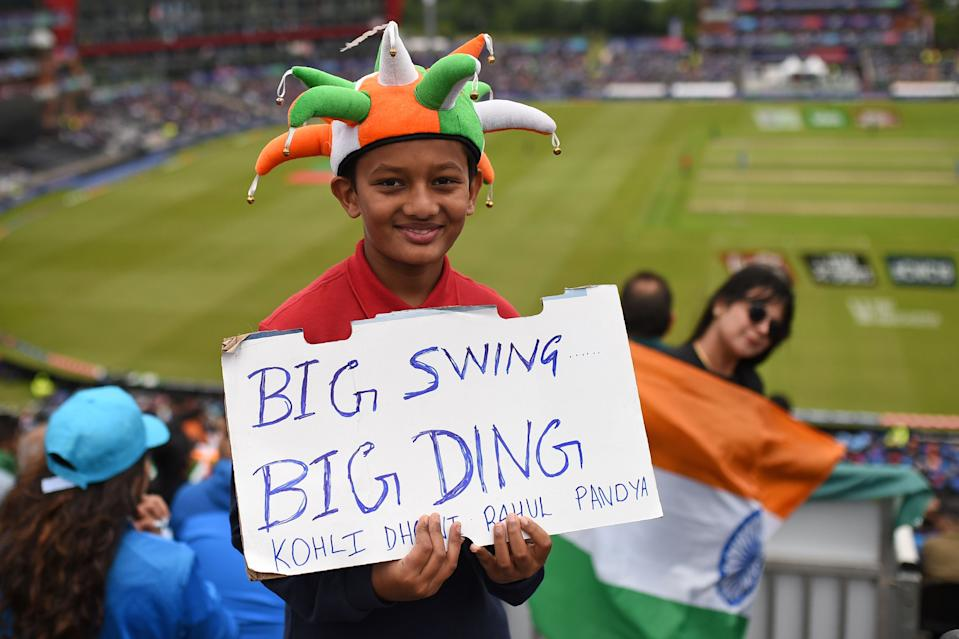 A young Indian supporter watching on as Sharma and KL Rahul start well for India (Photo by OLI SCARFF/AFP/Getty Images)