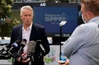 Craig Tiley, chief executive officer and Australian Open tournament director, tells reporters the tournament will go ahead despite Thursday's latest setback