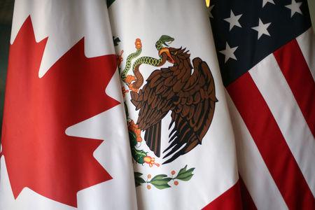 Flags are pictured during the fifth round of NAFTA talks involving the United States, Mexico and Canada, in Mexico City, Mexico, November 19, 2017. REUTERS/Edgard Garrido