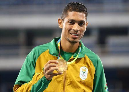 FILE PHOTO - 2016 Rio Olympics - Athletics - Victory Ceremony - Men's 400m Victory Ceremony - Olympic Stadium - Rio de Janeiro, Brazil - 15/08/2016. Gold medalist Wayde van Niekerk (RSA) of South Africa poses with his medal. REUTERS/Leonhard Foeger