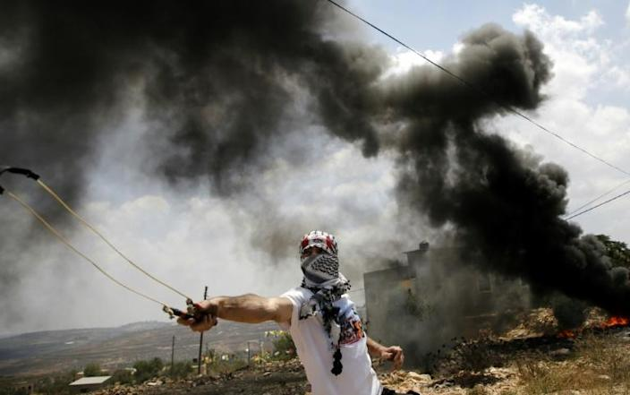 Kufr Qaddum is the scene of weekly protests by residents who want the village's main road to the nearby city of Nablus to be reopened (AFP Photo/JAAFAR ASHTIYEH)