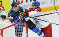 Czech Republic's Lukas Klok, right, pushes Finland's Atte Ohtamaa during the Ice Hockey World Championship quarterfinal match between Finland and Czech Republic at the Arena in Riga, Latvia, Thursday, June 3, 2021. (AP Photo/Sergei Grits)