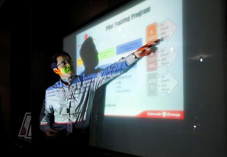 FILE PHOTO: General Manager of Lion Air's Angkasa Training Center, Capt. Dibyo Soesilo gestures as he explains the general training curriculum to the media at the airline group's training center near Jakarta