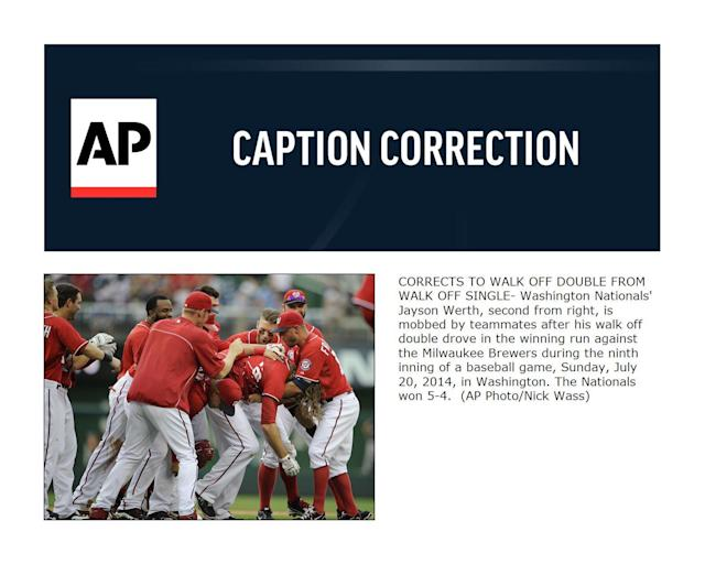 CORRECTS TO WALK OFF DOUBLE FROM WALK OFF SINGLE- Washington Nationals' Jayson Werth, second from right, is mobbed by teammates after his walk off double drove in the winning run against the Milwaukee Brewers during the ninth inning of a baseball game, Sunday, July 20, 2014, in Washington. The Nationals won 5-4. (AP Photo/Nick Wass)
