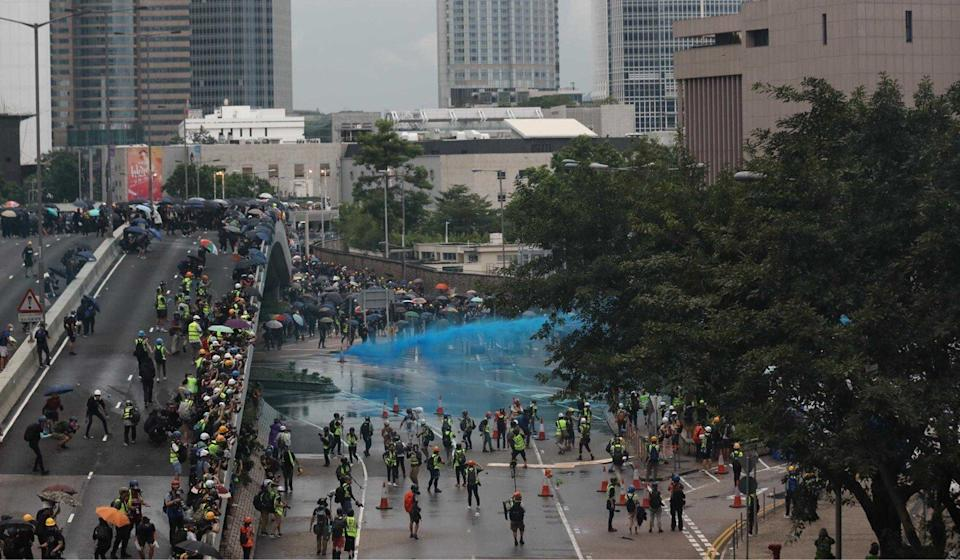 Police use a water cannon on protesters on August 31 last year. Photo: Xiaomei Chen