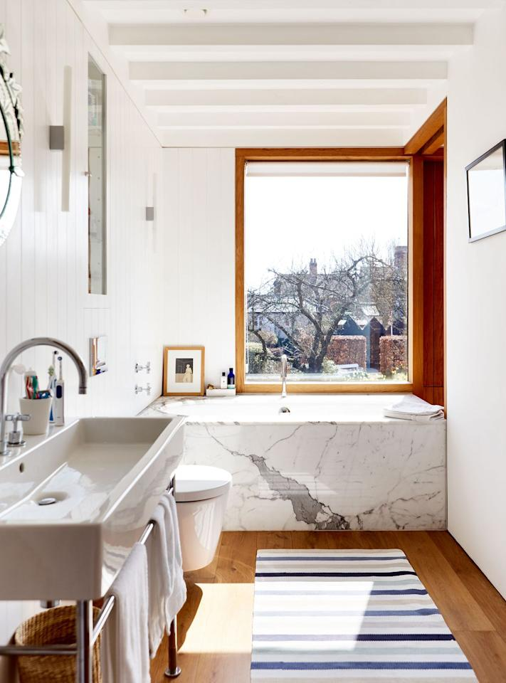 "<p>This stunning marble bathtub adds a touch of luxury to this modern cottage in Suffolk. </p><p><a class=""body-btn-link"" href=""https://www.housebeautiful.com/uk/renovate/homes-makeovers/a3302/modern-rustic-new-build-suffolk-cottage/"" target=""_blank"">TAKE A TOUR</a></p>"