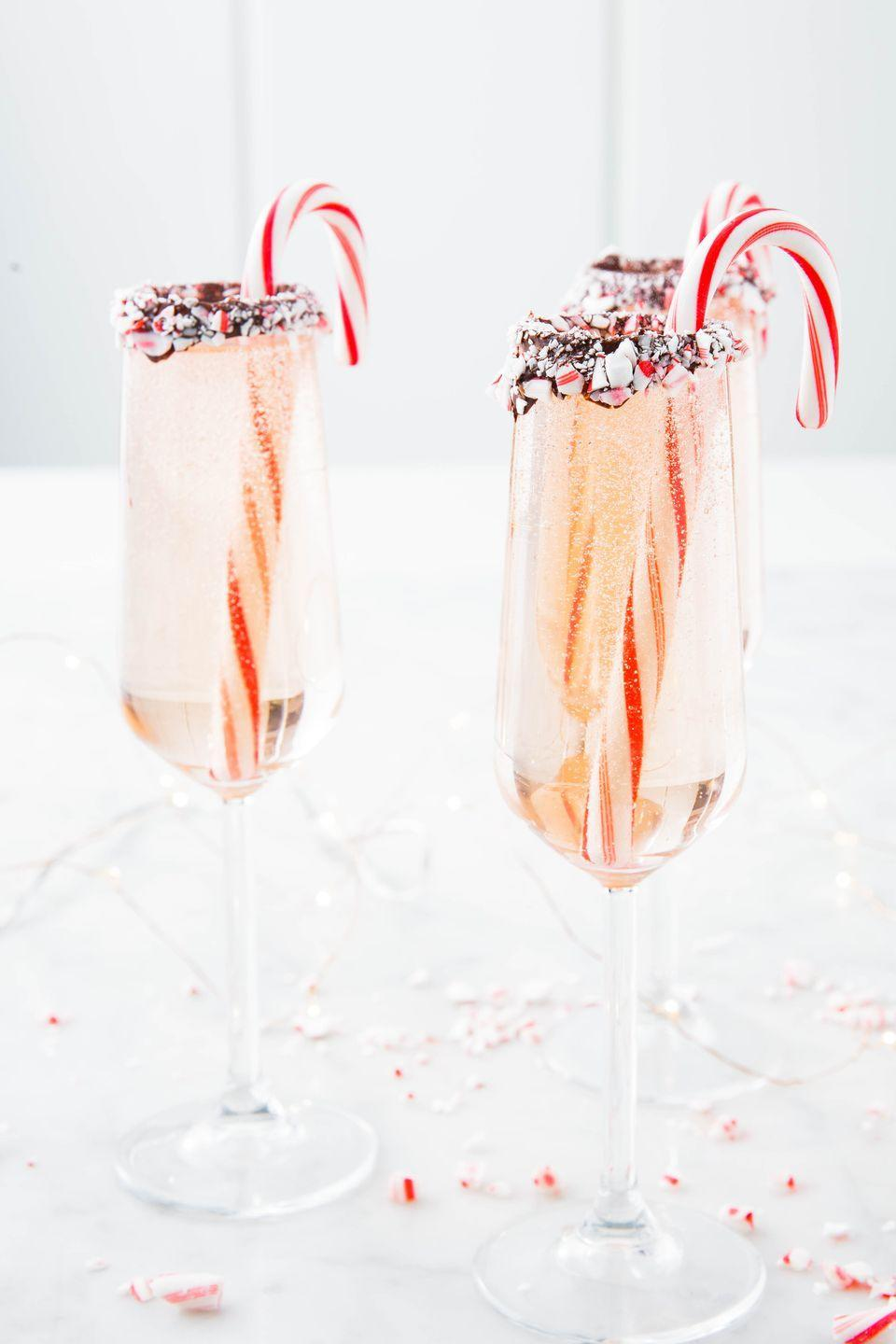 """<p>The perfect way to get into the holiday spirit. </p><p>Get the recipe from <a href=""""https://www.delish.com/cooking/recipe-ideas/a25128817/peppermint-bark-mimosas-recipe/"""" rel=""""nofollow noopener"""" target=""""_blank"""" data-ylk=""""slk:Delish"""" class=""""link rapid-noclick-resp"""">Delish</a>. </p>"""
