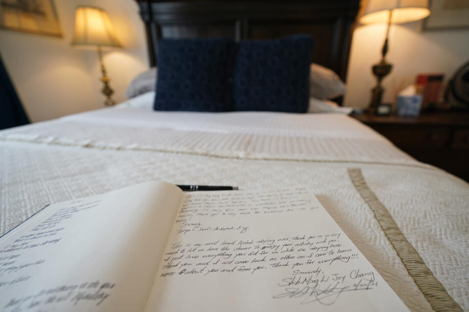 The guest book for the bed-and-breakfast The House of Bise Bespoke rests on a bed, Monday, July 19, 2021, in Cleveland. Small businesses in the U.S. that depend on tourism and vacationers say business is bouncing back, as people re-book postponed trips and take advantage of loosening restrictions, a positive sign for the businesses that have struggled for more than a year. Bise started in 2019 and catered to international tourists, attracting guests from New Zealand, Botswana, Eastern Europe and elsewhere. (AP Photo/Tony Dejak)