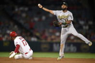Oakland Athletics shortstop Elvis Andrus, right, throws to first after forcing out Los Angeles Angels' Shohei Ohtani at second base during the eighth inning of a baseball game in Anaheim, Calif., Thursday, July 29, 2021. Phil Gosselin was safe at first base. (AP Photo/Kelvin Kuo)