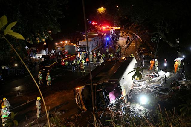 <p>Rescuers work at the site of a crashed bus in Hong Kong, China, Feb. 10, 2018. (Photo: China Daily via Reuters) </p>