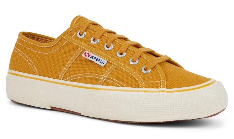 """Besides my trusty Birkenstocks and Crocs (I know, I know, but I'm converted!), I've only worn one style of footwear since lockdown: the canvas shoe. Whether it's my Keds, Converse, Novestas or Vans, there's something so simple about the breathable and comfortable plimsoll that feels appropriate right now. Enter my next favourite: Superga's classic 2490 COTU style in golden yellow. I'll be wearing with white jeans and ringer tees for a '70s summer look.<br><br><strong>Superga</strong> 2490 Cotu, $, available at <a href=""""https://www.superga.co.uk/item/2460/Superga/2490-COTU-Yellow-Golden.html?"""" rel=""""nofollow noopener"""" target=""""_blank"""" data-ylk=""""slk:Superga"""" class=""""link rapid-noclick-resp"""">Superga</a>"""