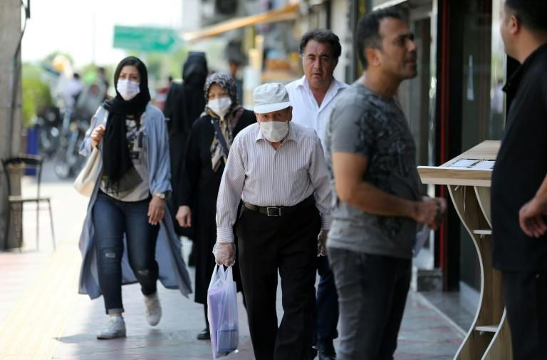 Iran announced new measures to combat the spread of the novel coronavirus as the country counted 144 new fatalities, its highest death toll for a single day in almost three months (AFP Photo/ATTA KENARE)
