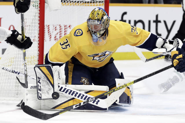Nashville Predators goaltender Pekka Rinne, of Finland, watches a shot against the Dallas Stars in the third period of an NHL hockey game, Saturday, Dec. 14, 2019, in Nashville, Tenn. The Stars won 4-1. (AP Photo/Mark Humphrey)