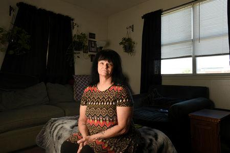 Cathy Sellars at her home in Fort Walton Beach, Florida, U.S. December 21, 2017. She is one of three women who filed a class action lawsuit claiming widespread sexual harassment at their former employer, CRST Expedited, Inc., a large long-haul trucking company in October 2015.  Picture taken December 21, 2017.   REUTERS/Michael Spooneybarger