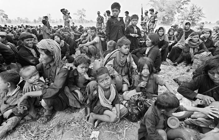 Cambodian youngsters gather in a knot within a crowd of older Khmers including soldiers of the toppled Pol Pot regime, following the group's escape across the frontier, April 16,1979, in Wong Mon, Thailand. (Photo: Jeff Robbins/AP)