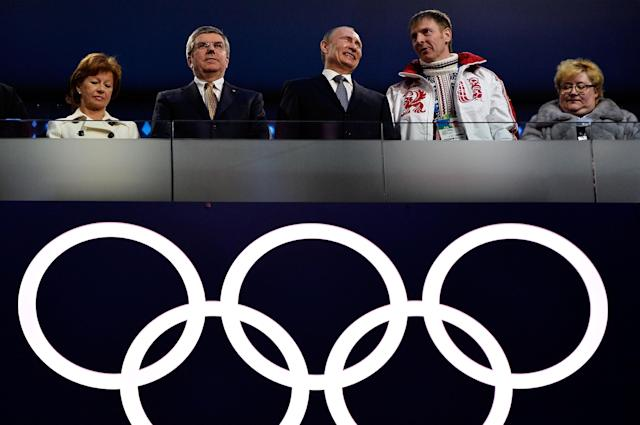 SOCHI, RUSSIA - FEBRUARY 23: (L to R) Claudio Bach, Thomas Bach, President of the IOC, Russian President Vladimir Putin and Russian Bobsleigh pilot Alexander Zubkov attend the 2014 Sochi Winter Olympics Closing Ceremony at Fisht Olympic Stadium on February 23, 2014 in Sochi, Russia. (Photo by Pascal Le Segretain/Getty Images)