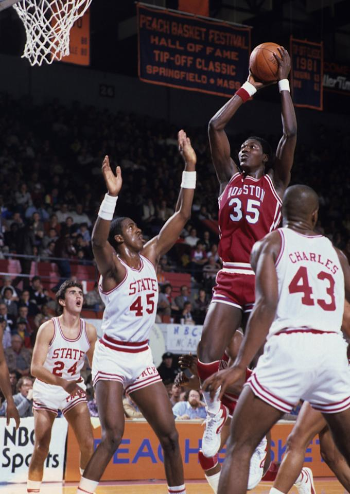 Hakeem Olajuwon of the Houston Cougars takes a shot against the North Carolina State Wolfpack on November 19, 1983 in Raleigh, North Carolina. (Photo by Ronald C. Modra/Sports Imagery/Getty Images)