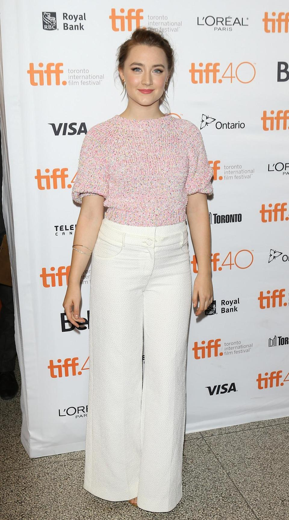 <p>Saoirse Ronan broke the white after Labor Day rule in the best way wearing white wide-legged pants with a pink sweater from Chanel's Resort 2016 collection.</p>