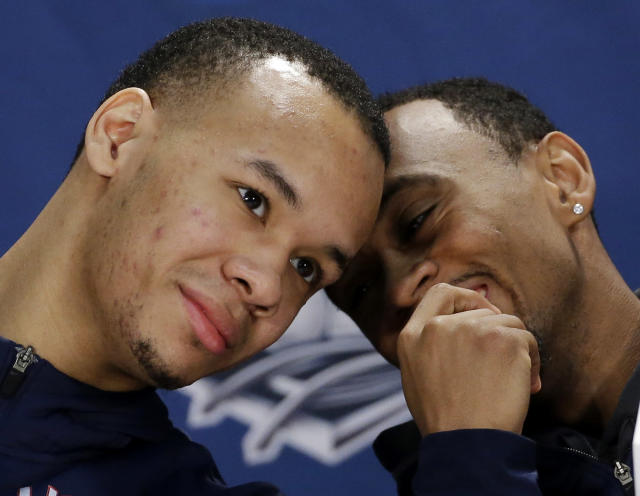 Connecticut guard Shabazz Napier, left, and guard Ryan Boatright chat during a news conference for the NCAA Final Four tournament college basketball championship game Sunday, April 6, 2014, in Arlington, Texas. Connecticut plays Kentucky in the championship game on Monday, April 7. 2014. (AP Photo/David J. Phillip)