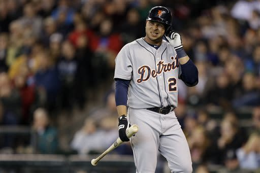 Detroit Tigers' Jhonny Peralta reacts to striking out with two on base in the seventh inning of a baseball game against the Seattle Mariners, Thursday, April 18, 2013, in Seattle. (AP Photo/Ted S. Warren)