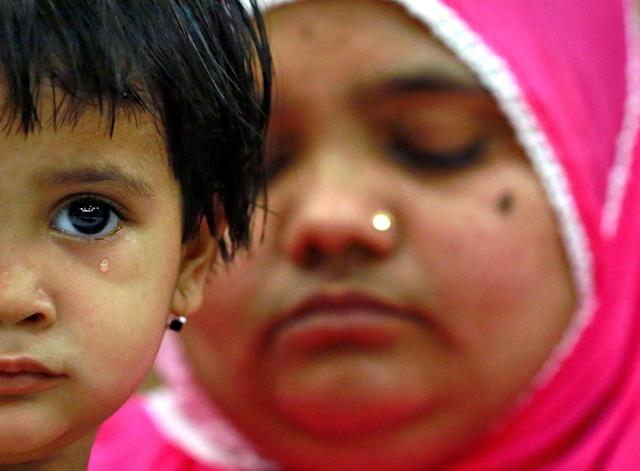 <p>Aksha Yakub Rasool, 2, sits on her mother Bilkis Bano's (R) knee during a press conference in New Delhi, India May 8, 2017. Bilkis was gang raped and fourteen of her relatives, including her three-year-old daughter, were killed during religious riots that broke out in Gujarat in 2002. Last week a court in Mumbai upheld the conviction of 11 men to life in prison for the rape and murder. (Cathal McNaughton/Reuters) </p>