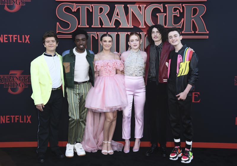 "Gaten Matarazzo, Caleb McLaughlin, Millie Bobby Brown, Sadie Sink, Finn Wolfhard and Noah Schnapp arrive at the season three premiere of ""Stranger Things"" at Santa Monica High School on Friday, June 28, 2019, in Santa Monica, Calif. (Photo by Jordan Strauss/Invision/AP)"