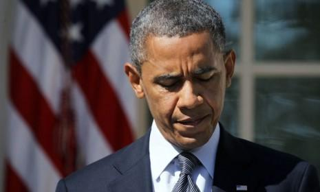 """President Obama makes his first remarks about the Sept. 11 Benghazi attack in the White House Rose Garden on Sept. 12. He vowed that the U.S. would not tolerate """"acts of terror."""""""