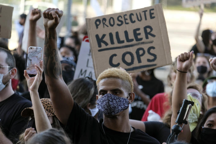Demonstrators protest the killing of George Floyd in downtown Los Angeles Wednesday. (AP Photo/Ringo H.W. Chiu)