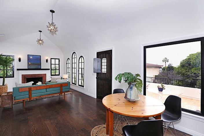 """<p>""""Hunter's willingness to try things that other designers won't is a real difference maker,"""" says real estate agent Tracy Do, who listed the house this summer. """"Many designers are content to play it safe."""" The picture window in the dining area, right, overlooks the front patio.<i> (Photo: Charmaine David for Kenihan Development)</i></p>"""