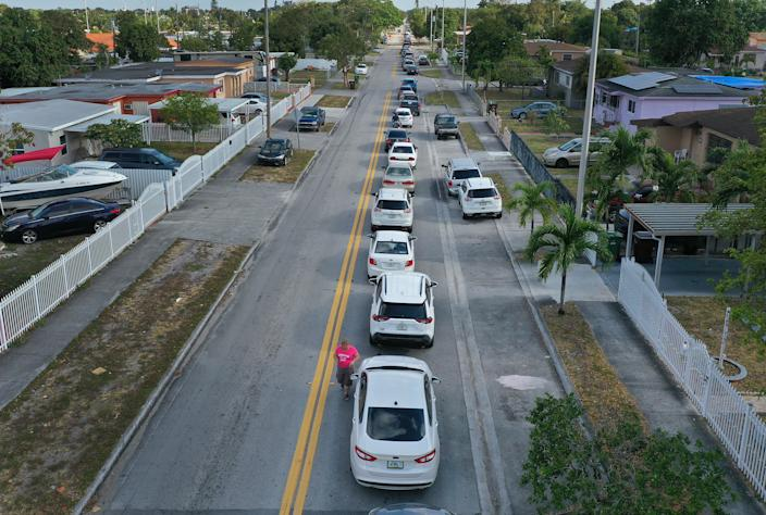 People line up for unemployment applications in Hialeah, Fla.