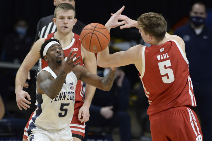 Penn State's Jamari Wheeler (5) and Wisconsin's Tyler Wahl (5) reach for the ball during the second half of an NCAA college basketball game, Saturday, Jan. 30, 2021, in State College, Pa. (AP Photo/Gary M. Baranec)