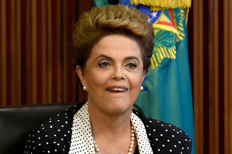 Brazilian President Dilma Rousseff is battling both declining economic output and 10.67 percent inflation (AFP Photo/Evaristo Sa)