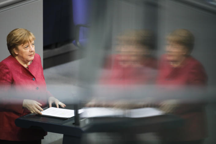 German Chancellor Angela Merkel delivers her speech during a parliament session about a new law to battle the coronavirus pandemic at the parliament Bundestag in Berlin, Germany, Friday, April 16, 2021. (AP Photo/Markus Schreiber)