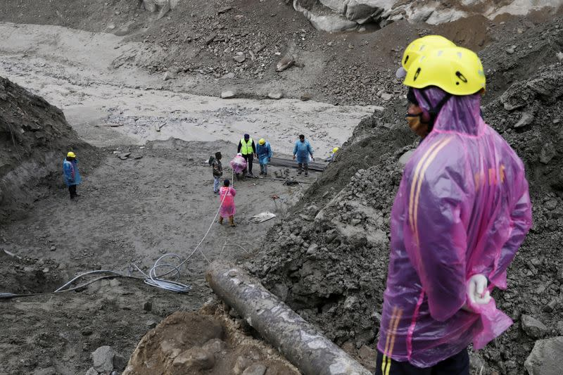 Rescue operation after a part of a glacier broke away, in Raini village