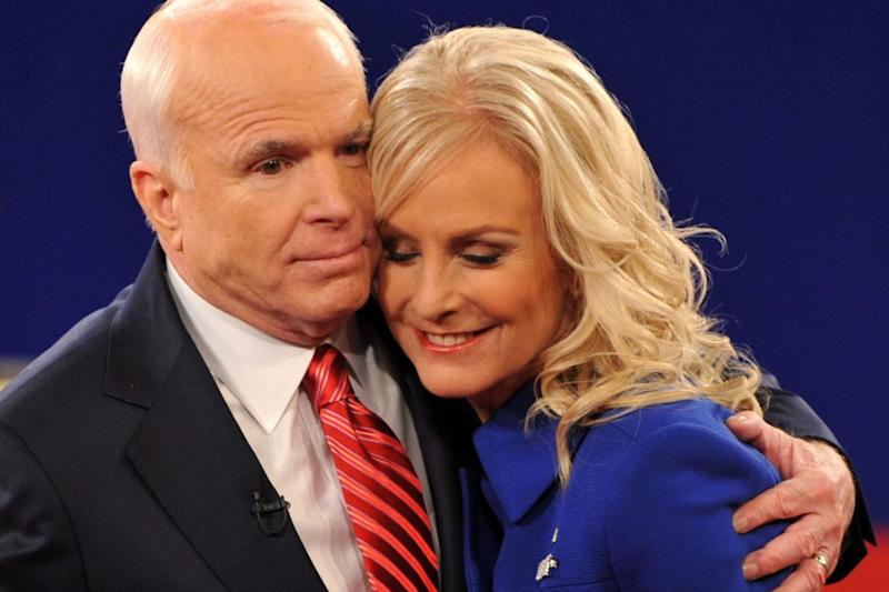 Republican John McCain embraces his wife Cindy following his second presidential debate with Democrat Barack Obama in 2008 (AFP/Getty Images)