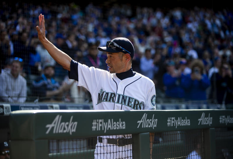 SEATTLE, WA - MAY 01: Former Seattle Mariners outfielder Ichiro Suzuki, now an instructor with the team, waves from the dugout during a moment of acknowledgement from the team during the second inning against the Chicago Cubs at T-Mobile Park on May 1, 2019 in Seattle, Washington. (Photo by Lindsey Wasson/Getty Images)