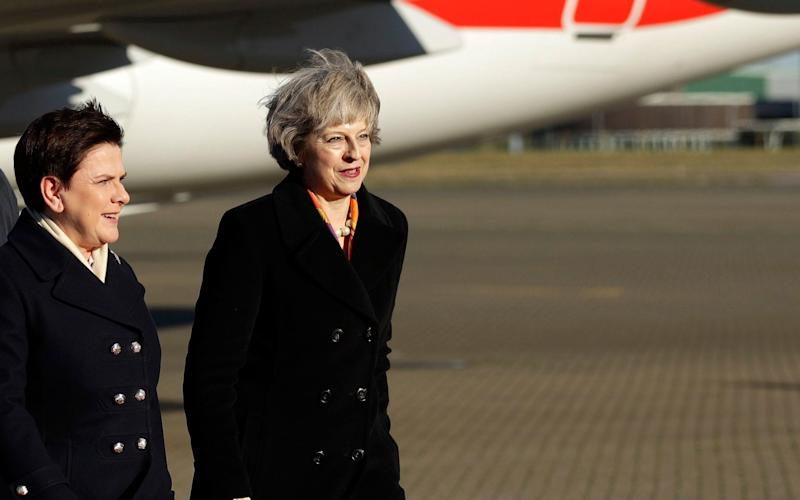 Prime Minister Theresa May (right) greets Polish Prime Minister Beata Szydlo on her arrival at RAF Northolt, London - PA Wire/PA Images