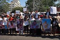 Demonstrators protest outside the Thai embassy in Yangon on December 25, 2015 against the death sentence of Myanmar workers Zaw Lin and Win Zaw Tun for the murder of two British tourists (AFP Photo/Phyo Hein Kyaw)