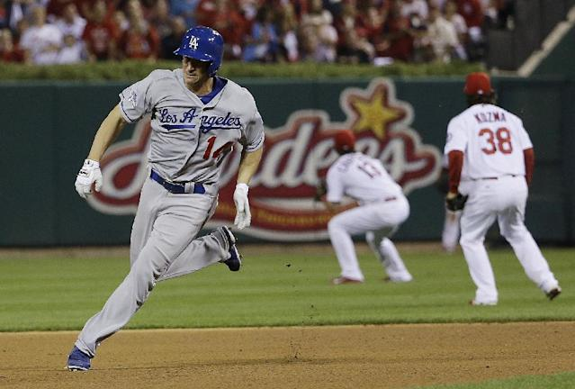 Los Angeles Dodgers' Mark Ellis races to third for a triple during the 10th inning of Game 1 of the National League baseball championship series against the St. Louis Cardinals, Friday, Oct. 11, 2013, in St. Louis. (AP Photo/David J. Phillip)