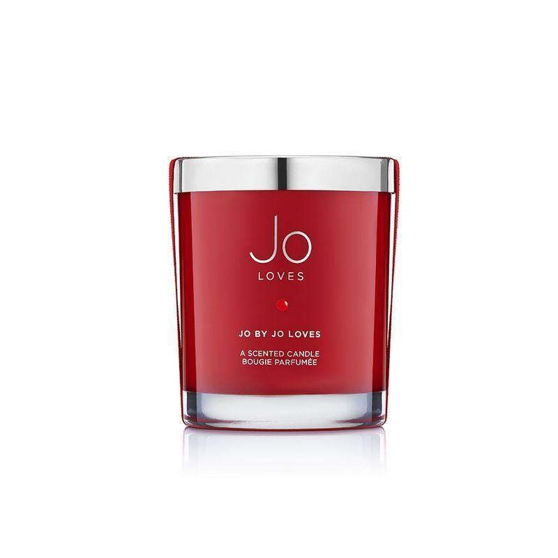 """<p>Jo by Jo Loves</p><p>£55</p><p>Spacenk.com</p><p><a class=""""link rapid-noclick-resp"""" href=""""https://go.redirectingat.com?id=127X1599956&url=https%3A%2F%2Fwww.spacenk.com%2Fuk%2Fen_GB%2Ffragrance%2Fhome-fragrance%2Fcandle%2Fjo-by-jo-loves-a-candle-UK200028276.html&sref=https%3A%2F%2Fwww.harpersbazaar.com%2Fuk%2Fbeauty%2Ffragrance%2Fg30698193%2Fbest-scented-candles%2F"""" rel=""""nofollow noopener"""" target=""""_blank"""" data-ylk=""""slk:SHOP NOW"""">SHOP NOW</a></p><p>Legendary perfumer Jo Malone has created countless cherished scents throughout her career, but this is the first fragrance she made for herself. So popular, the brand released it in candle form, Jo By Jo Loves is citrussy without being overly summery, thanks to the soft cedarwood in the base.</p>"""