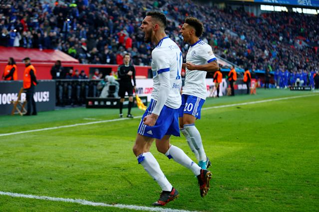 Soccer Football - Bundesliga - Bayer Leverkusen vs Schalke 04 - BayArena, Leverkusen, Germany - February 25, 2018 Schalke's Nabil Bentaleb celebrates scoring their second goal from the penalty spot with Thilo Kehrer REUTERS/Thilo Schmuelgen DFL RULES TO LIMIT THE ONLINE USAGE DURING MATCH TIME TO 15 PICTURES PER GAME. IMAGE SEQUENCES TO SIMULATE VIDEO IS NOT ALLOWED AT ANY TIME. FOR FURTHER QUERIES PLEASE CONTACT DFL DIRECTLY AT + 49 69 650050