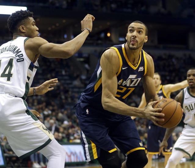 "<a class=""link rapid-noclick-resp"" href=""/nba/players/5197/"" data-ylk=""slk:Rudy Gobert"">Rudy Gobert</a>, right, reportedly suffered a sprained MCL in his left knee Friday. (AP)"