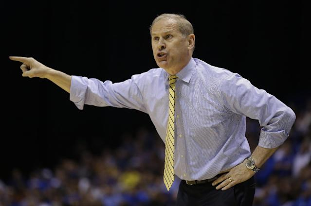 Michigan head coach John Beilein gestures during the first half of an NCAA Midwest Regional final college basketball tournament game against Kentucky Sunday, March 30, 2014, in Indianapolis. (AP Photo/Michael Conroy)