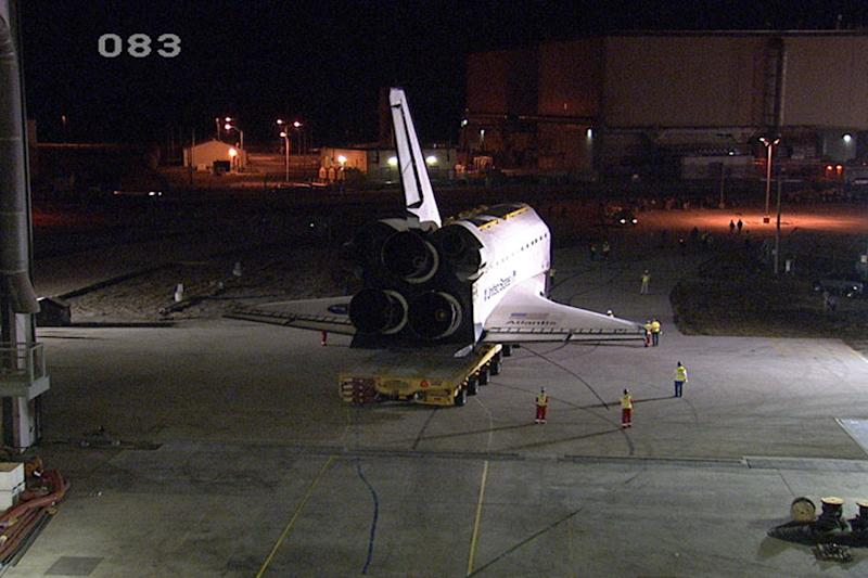This image from video provided by NASA-TV shows the Space shuttle Atlantis departing the Vehicle Assembly Building at NASA's Kennedy Space Center in Florida for the last time early Friday Nov. 2, 2012. The spacecraft is moving to the Kennedy Space Center Visitor Complex, where it will be featured in a new display slated to open in July 2013. (AP Photo/NASA-TV)