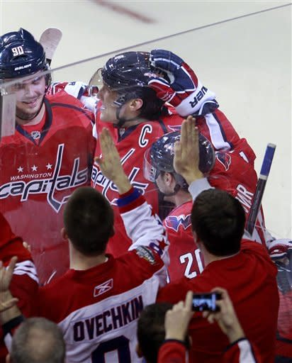 Washington Capitals left wing Alex Ovechkin, top center, of Russia, celebrates his goal with teammate Marcus Johansson, left, of Sweden during the second period of an NHL hockey game against the Florida Panthers, Tuesday, Feb. 7, 2012, in Washington. (AP Photo/Haraz N. Ghanbari)