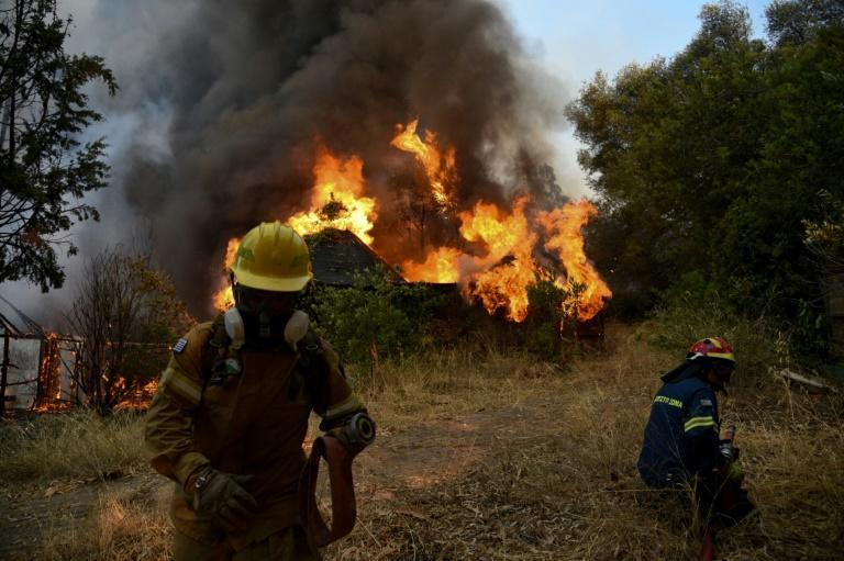 Nearly 300 firefighters, two water bomber planes and five helicopters battled a forest fire in Greece