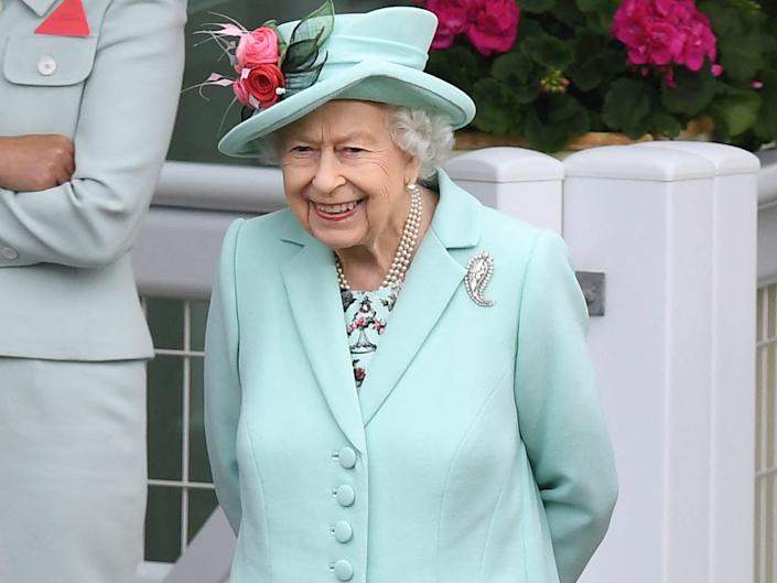 Queen Elizabeth II reacts ahead of racing on the fifth day of the Royal Ascot horse racing meet.