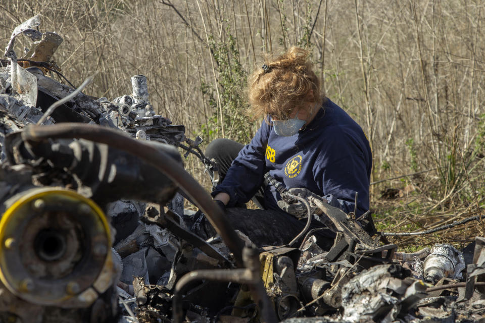 CALABASAS, CA - JANUARY 27: In this handout photo provided by the National Transportation Safety Board, an investigator works at the scene of the helicopter crash that killed former NBA star Kobe Bryant and his 13-year-old daughter Gianna on January 27, 2020 in Calabasas, California. All nine people on board, including the pilot, perished in the crash as they were flying to Bryant's Mamba Sports Academy in Thousand Oaks, where he was going to coach Gianna in a tournament game. (Photo by James Anderson/National Transportation Safety Board via Getty Images)