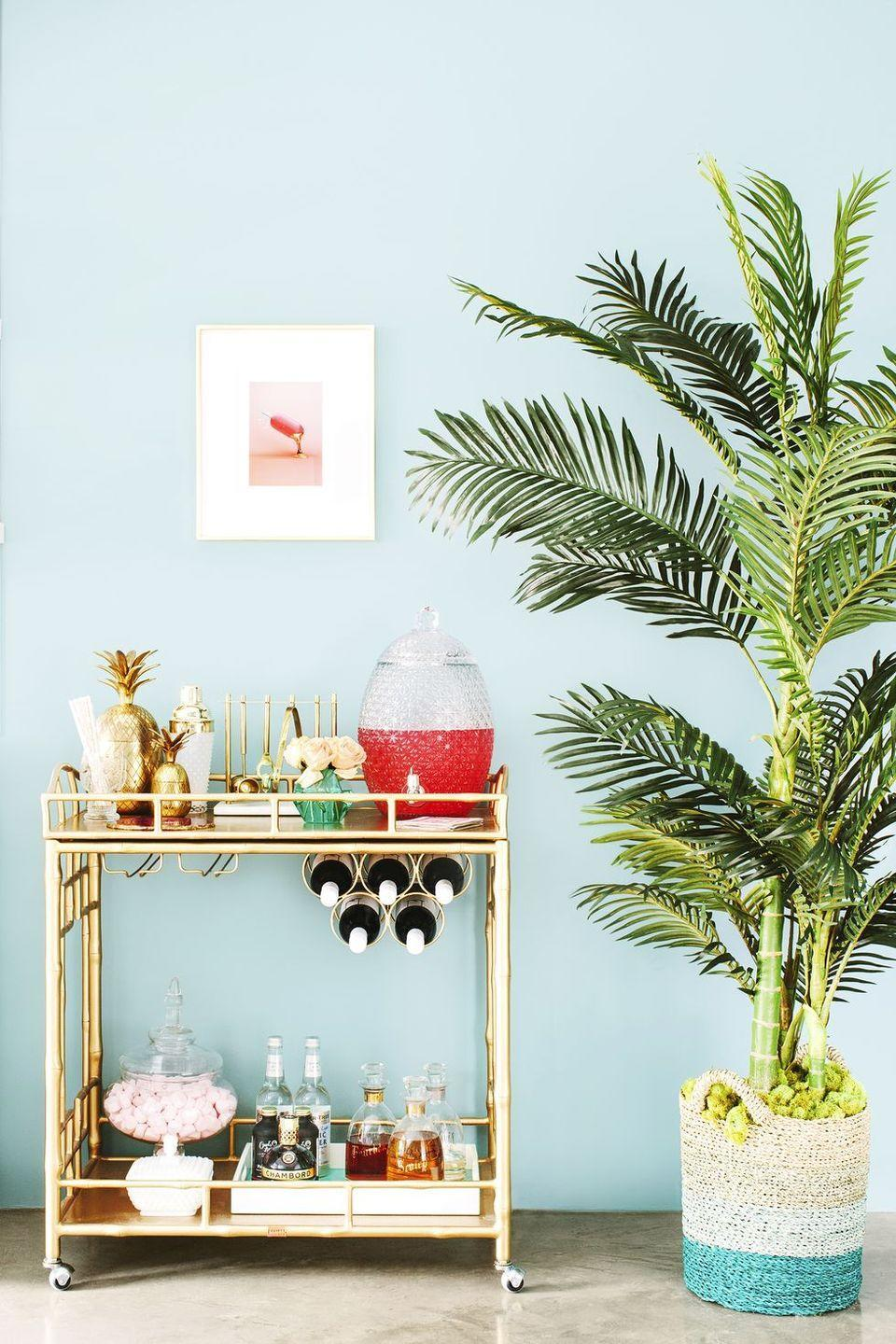 "<p>One of the best ways to boost your mood and add personality to your space is with greenery. Go for an oversized plant, like a Parlor Palm or Yucca, to make a huge impact. </p><p><strong>RELATED: </strong><a href=""https://www.goodhousekeeping.com/home/gardening/g26477167/best-indoor-trees/"" rel=""nofollow noopener"" target=""_blank"" data-ylk=""slk:10 Best Indoor Trees for a Happier Home"" class=""link rapid-noclick-resp"">10 Best Indoor Trees for a Happier Home</a></p>"