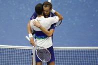 Daniil Medvedev, of Russia, right, hugs Novak Djokovic, of Serbia, after defeating Djokovic during the men's singles final of the US Open tennis championships, Sunday, Sept. 12, 2021, in New York. (AP Photo/Seth Wenig)